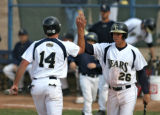 Bears Chad Murray, left, is congratulated by teammate Mike Raudenbush, after scoring a run during...