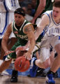 (Denver, Colo. Shot on March 11, 2004)  Colorado State Rams Dwight Boatner, left, #5, lunges for a...