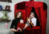 Media consultant Gina London, her husband, circus performer Scotty Walsh, and their baby daughter,...