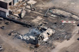 The remains of a building smolders in Ordway, Colo.,  Wednesday, April 16, 2008, after a fire...