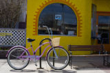 A pink bike is locked up on 32nd street in Highland square on April 15, 2008. Eat! Drink! Shop!...