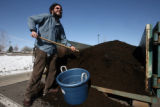Adam Bratter (cq) the mail room coordinator at White Wave Foods in Broomfield with compost...
