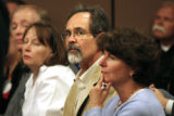 Tom Engel, middle, listens as an attorney addresses the court Thursday afternoon during a hearing...