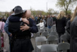 Trooper Scott Hinshaw (cq) hugs State Patrol Officer Ross Koukol (cq) after the Colorado Law...