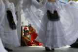DM1672  Two little girls with the Fiesta Colorado dancers watch as the older girls perform during...