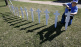 DM6233  Nancy Dzurilla, 38, of Colorado Springs stakes crosses into the ground for the 13 victims...
