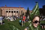 (048) - A girl dresses up as a marijuana leaf to celebrate April 20, the annual pro-pot rally...