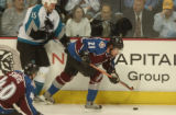 (Denver,CO,Shot On 4/28/04-- Colorado Avalanche Peter Forsberg, 21,  races to the puck by San Jose...