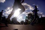 [Boulder, CO - Shot on: 5/31/04] Citizen runners head past the 8.5 mile marker along Folsom St. in...