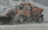 A CDOT snow plow clears snow on westbound I-70 just before the Eisenhower tunnel Sunday afternoon...