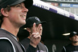 BG0582 Colorado Rockies Brad Hawpe, left, and Troy Tulowitzki watch a highlight video before they...