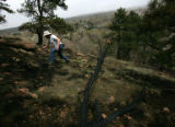 Steven Reinhold (cq), of Frederick, hikes through an area damaged by a two-acre fire at Settler...
