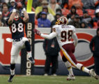 Denver Broncos tight end, Jeb Putzier, right, makes good on a 31-yard-catch with 13:47 left in the...