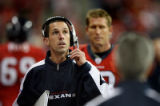 Houston Texans quarterback coach, Kyle Shanahan, looks up at the jumbo scoreboard  for an instant...