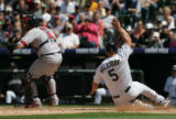 Matt Holliday slides into home in the 4th inning of the Colorado Rockies against the St. Louis...