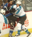 (Denver,CO,Shot On 4/28/04-- Colorado Avalanche Kurt Sauer, 34, gets hit against the boards by San...