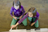 Rocky Mountain News employee, Ivo Majetic brought his twin daughters on the left, Iva, 10, and on...