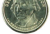 The front of the new Washington dollar coin, Thursday February 15, 2007, in Rocky Mountain Coin,...