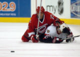 CANESSENS3.SP.102405.CCS--- The Canes Bret Hedican, 6, battles the Senators Antoine Vermette, 20,...