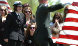 Seaman Daisy Tucker, sister of killed soldier, Spec. Ronald Tucker, becomes emotional as she...
