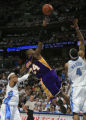 DM0124  Los Angeles Kobe Bryant shoots off balance in the first half as the Nuggets host the...