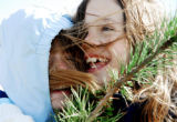 Renaissance Magnet third-graders Diana Alderson, 8, left, and Hannah Nordling, 9, huddle close...