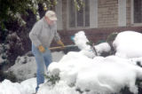 Aurora resident Bud Fouts (cq) shovels off his sidewalk on Lansing Street during the snowstorm on...