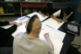 Cody Espinosa (cq), 13, (with the mohawk) studies the techniques of artist Jacob Lawrence from the...