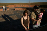 MJM214144  Stephanie Weems (cq), center, reads a portion of the Columbine Memorial at Clement Park...
