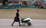 (NYT67) MAPUTO, Mozambique -- Oct. 6, 2005 -- MOZAMBIQUE-SYMBOLS -- A mural celebrating the civil...
