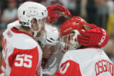 BG0506 Detroit Red Wings Chris Osgood #30, right, is congratulated bu his teammates after beating...