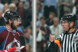 BG0480 Colorado Avalanche Peter Forsberg #21 argues a call with a referee as the lose to the...