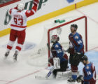 DM0201  Colorado Avalanche Jordan Leopold #44, Ian Laperriere and goalie Jose Theodore look up in...