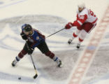 DM0405  Colorado Avalanche Paul Stastny #26 is hooked Detroit Red Wings Tomas Holmstrom #96 in the...