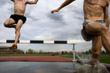 Billy Nelson (cq) and Pete Janson (cq) jump over a barrier into a water pit at the photographers...