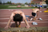 Billy Nelson (cq) stretches during track practice at Potts Field in Boulder. Nelson and his...