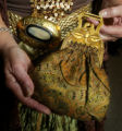 (Denver, Colo., October 22, 2005) Fashions at Western Fantasy:  Evelyne Shaffer's purse with a...
