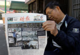 LA102 - A man  reads a Chinese language newspaper Tuesday, May 13, 2008, in the Chinatown section...