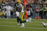 Green Bay's Donald Driver (80) runs the ball in the first quarter as the Denver Broncos play the...