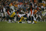 Denver Broncos' Andre Hall is brought down by the Green Bay defense in the first quarter as the...