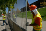 DM0020  Workers put up barricades and fences along the parade route on the Auraria Campus  in...
