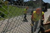 DM0034  Workers put up barricades and fences along the parade route on the Auraria Campus  in...