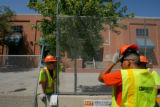 DM0044  Workers put up barricades and fences along the parade route on the Auraria Campus  in...