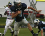 Ralston Valley's QB Liam Felton gains yards in 1st quarter at the North Area Athletic Complex in...
