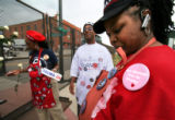 (202) Sporting a pro-Obama pink button, Sam Young of Houston, Texas, stands selling buttons and...
