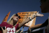 Kaitlin Mahoney, 23, of Washington, D.C., left,  argues with Jay Becker, of Chicago, over abortion...