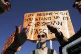 Kaitlin Mahoney, 23, of Washington, D.C., left, argues with a pro-choice protester as Alayna...