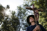 Rich Mahoney, of Lady Guadeloupe Church of Baton Rouge, holds a crucifix during a protest outside...