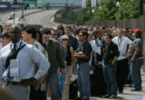 MJM068 Media and other people with credentials for the Democratic National Convention wait in a...