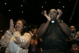 Mary McNeil-Jones and Pastor Dr. Calvin L. Kelly (both cq'd) applaud as Richard Smallwood and...